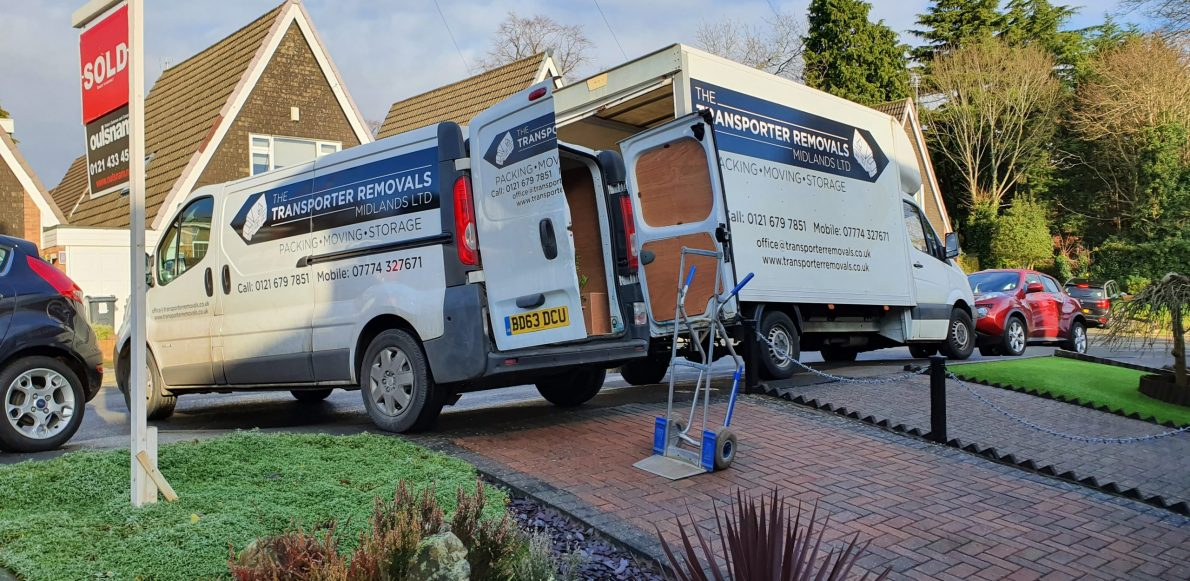An image of two removal vans outside a house.